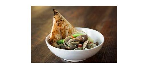 Scott Barnett Eureka's starter menu includes steamers, which are Manila clams with garlic, herbs, sherry wine served with grilled ciabatta.